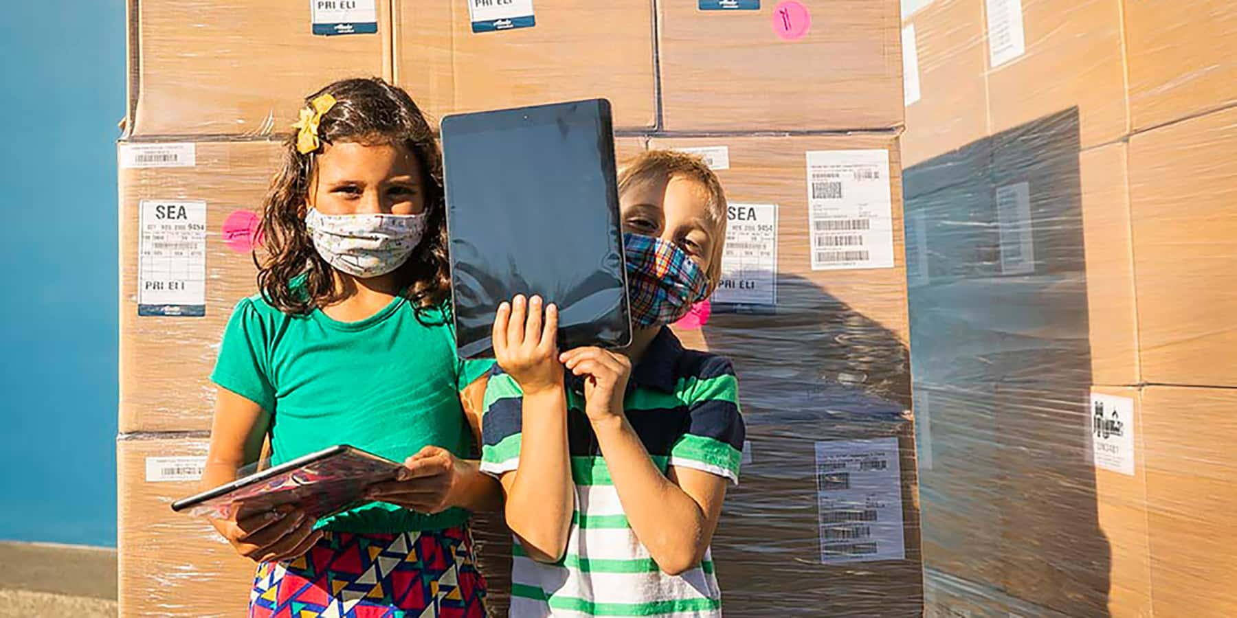 Alaska Air Cargo delivers 12,000 iPads to kids.